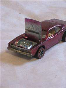 Here is a vintage 1968 Hot Wheels Custom Dodge Charger with magenta